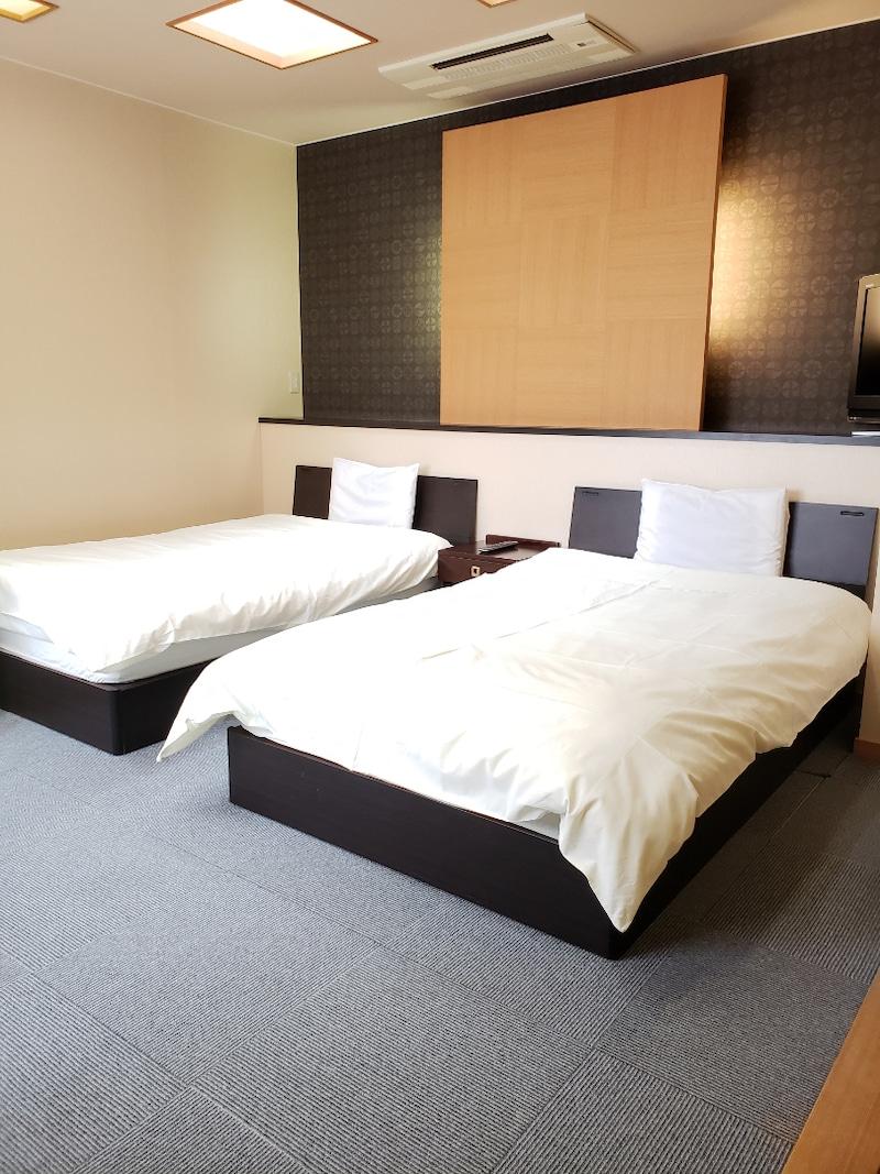 福井県あわら温泉のベッド付き寝室